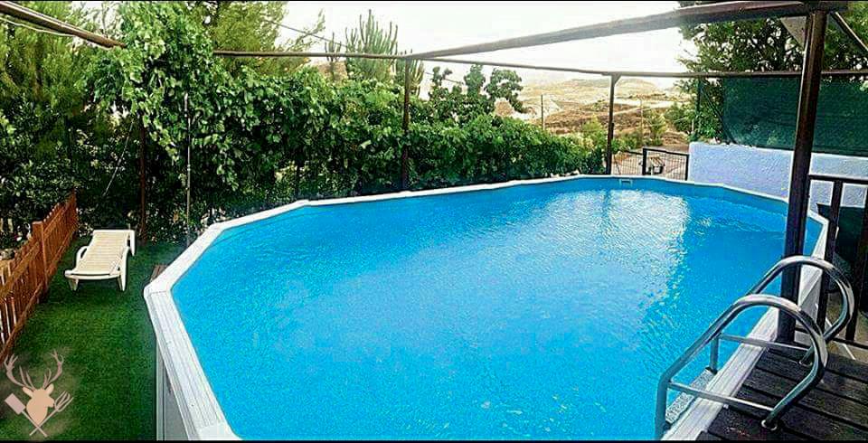 Exteriores, piscina privada.